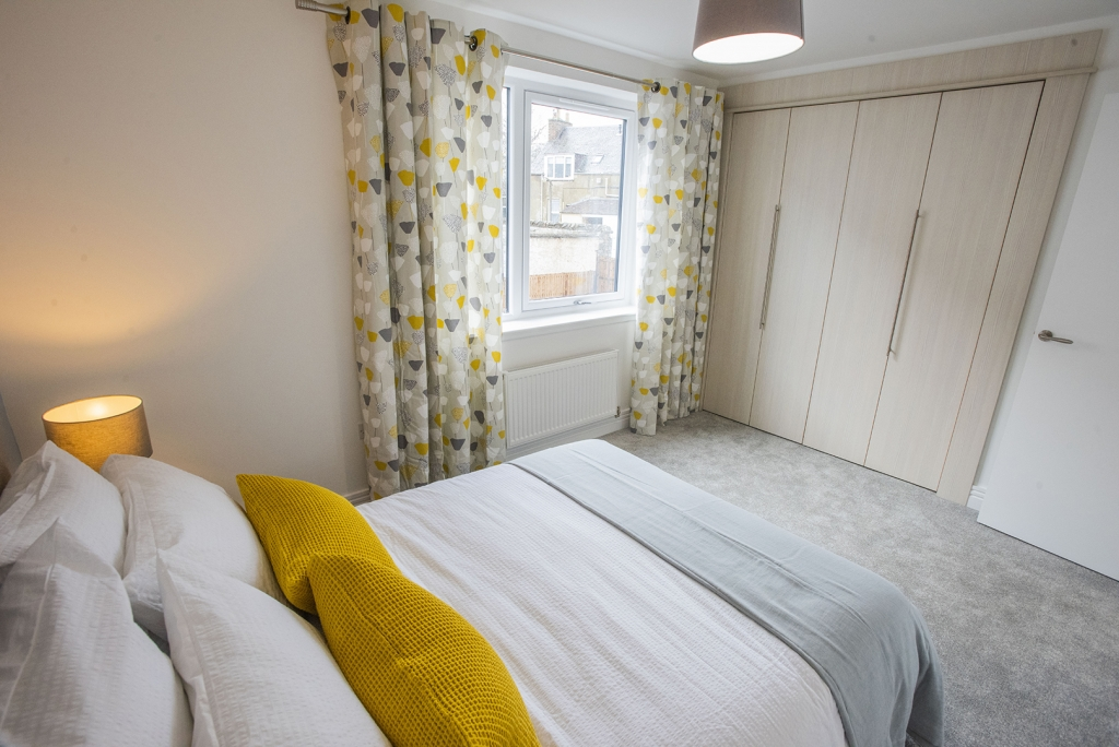 A spacious double bedroom at Caerlee Mill