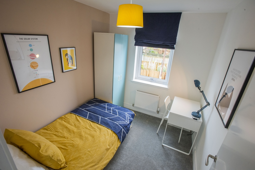 A colourful single bedroom at Carelee Mill