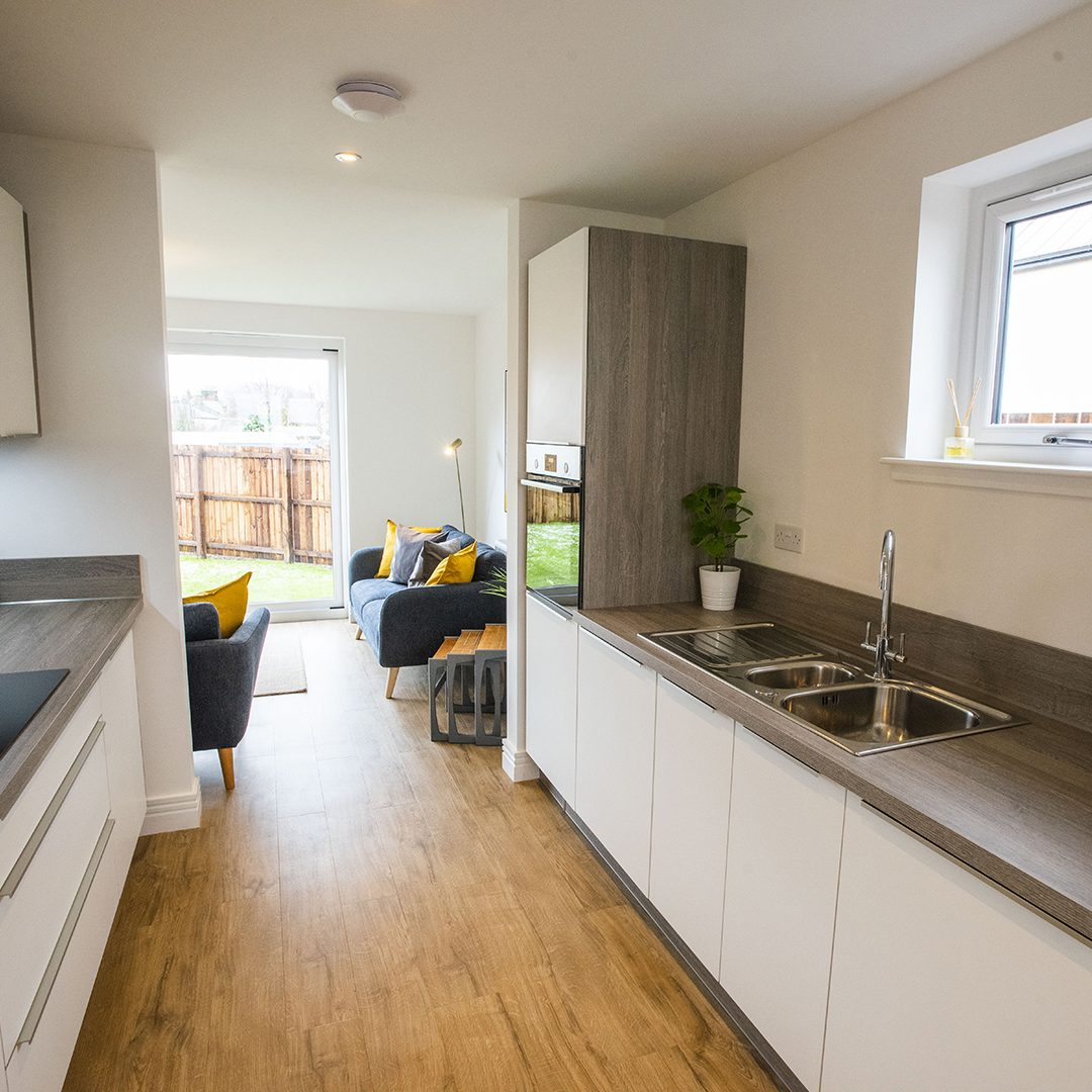 Clear open worksurfaces in a modern Caerlee Mill kitchen