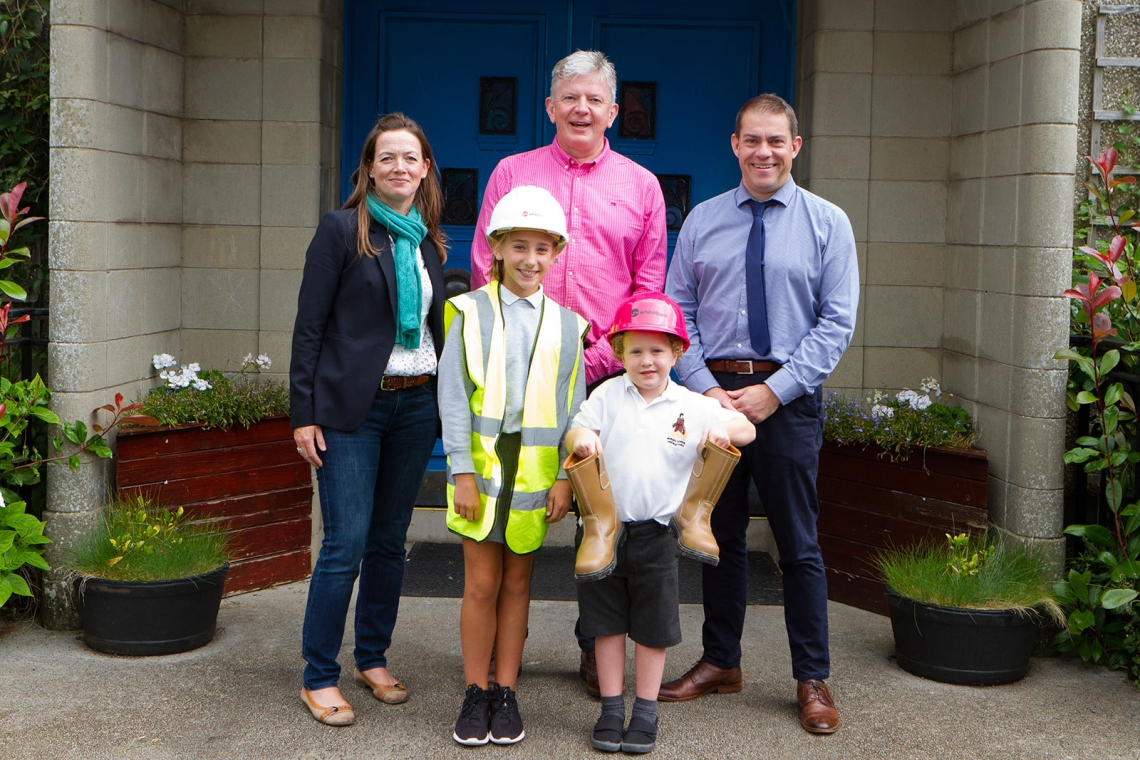 Eve McCurrich, Managing director of Whiteburn Projects Ltd with Roger Bainbridge (Director) and Keith Belleville (Head Teacher), giving a presentation to St Ronan's Primary School pupils on construction site safety.